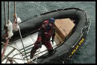 Tim Davis in adverse weather loading his zodiac off of Deception Island