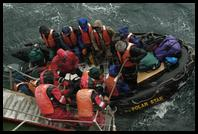 Zodiac passengers in adverse weather off of Deception Island
