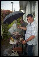 Arthur & Raymond grilling in the rain