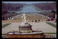 Statue at Versailles in front of some of the area damaged by the December 26, 1999 wind storm.  Winds reached 160 kph and raized an estimated 10,000 rare and historic trees (damage estimated at $37 million)