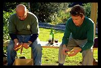 John and Anthony peeling potatoes and talking business on the back porch