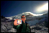 Matt and a can of SPAM with Chimborazo in the background after the storm